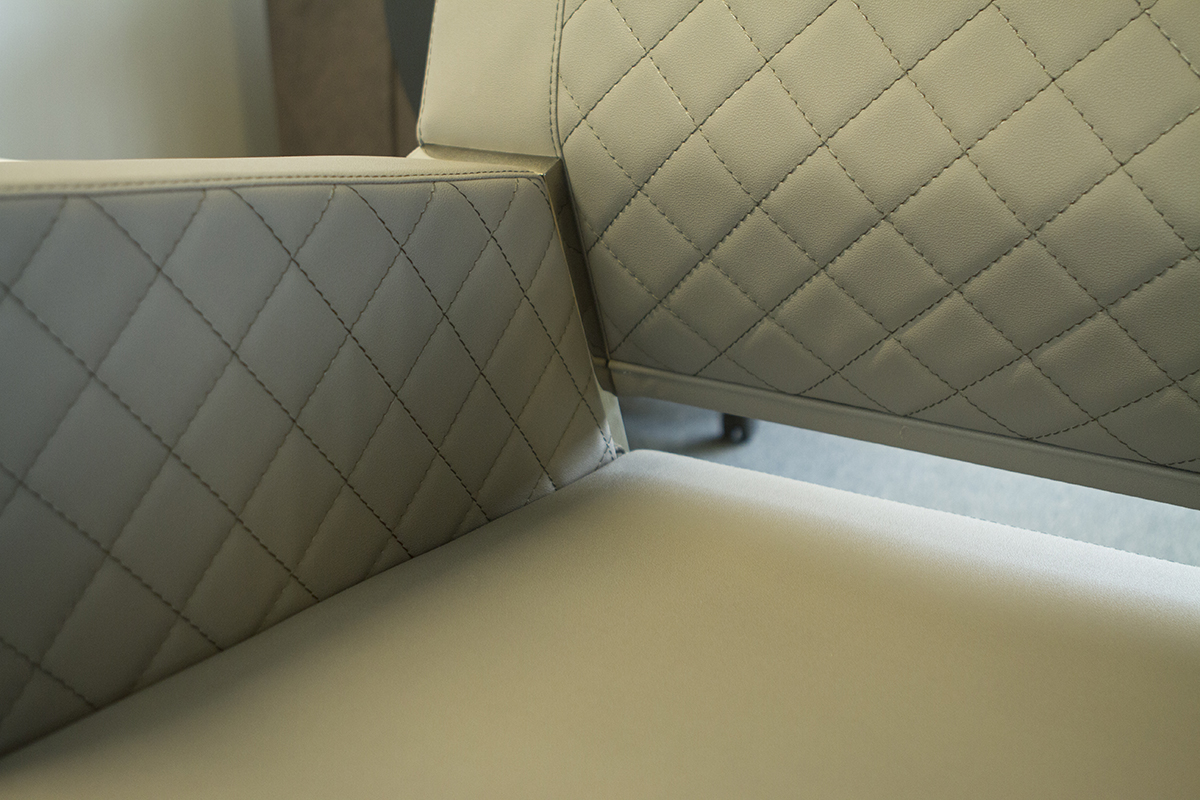 sofas for waiting areas with a modern design quilted cushions